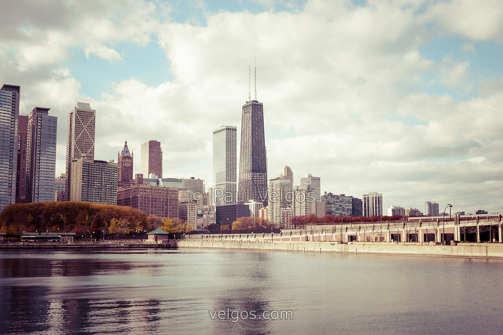 Chicago skyline vintage photo with the John Hancock building and Lake Michigan shoreline. Picture has a vintage retro tone. Image Copyright © Paul Velgos All Rights Reserved.