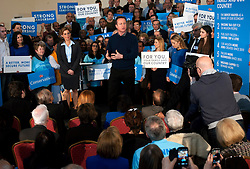 © Licensed to London News Pictures. 07/03/2015. <br /> LONDON, UK. British Prime Minister, David Cameron (C,R) accompanied by Conservative MP for Harrow, Hannah David (C,L) delivers a speech in North London to mark two months until the General Election today, London, Saturday 07 March 2015. Photo credit : Hannah McKay/LNP