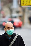 Man wears face mask for hygiene and protection on Nanjing Road, central Shanghai, China