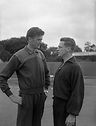 02/07/1960<br /> 07/02/1960<br /> 02 July 1960<br /> A.A.U. All-Ireland Championships 1960, Santry Stadium, Dublin. B.O'Reilly, Donore Harriers, (left) Senior High Jump competitor and D. Morris, Collegians A.C., holder of the Youths High Jump, discuss tactics before their respective competitions.