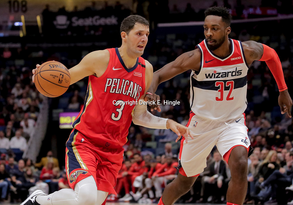 Nov 28, 2018; New Orleans, LA, USA; New Orleans Pelicans forward Nikola Mirotic (3) drives past Washington Wizards forward Jeff Green (32) during the second half at the Smoothie King Center. Mandatory Credit: Derick E. Hingle-USA TODAY Sports