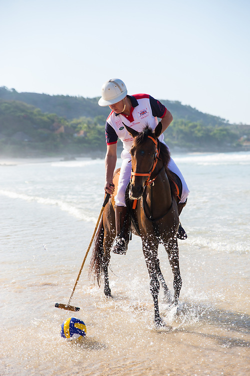 Nihiwatu founder and co-owner James McBride shows off his polo skills in the surf on the beautiful beaches of Sumba.