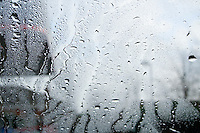 Water on car windscreen during automatic car wash