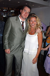 Writer PAUL BURKE ans his wife SASKIA at a party to celebrate the publication of The Man Who Fell in Love With His Wife by Paul Burke held at The Groucho Club, 45 Dean Street, London W1 on 12th July 2004.