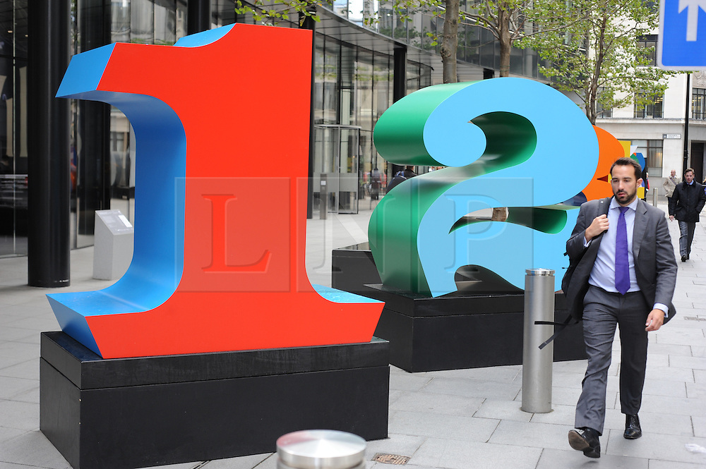 © Licensed to London News Pictures. 11/10/2013<br /> Sculpture in the City 2013. Delivered in partnership with city businesses and the wider arts community.<br /> One Through Zero  (The Ten Numbers) by Robert Indiana.<br /> The Numbers Sculptures Lime Street, The City of London.<br /> The Numbers sculptures are a monumental example of Robert Indiana's long held fascination with the power of numbers. For Indiana the number one represents birth. <br /> Photo credit :Grant Falvey/LNP