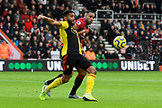 Adrian Mariappa (6) of Watford battles for possession with Callum Wilson (13) of AFC Bournemouth during the Premier League match between Bournemouth and Watford at the Vitality Stadium, Bournemouth, England on 12 January 2020.