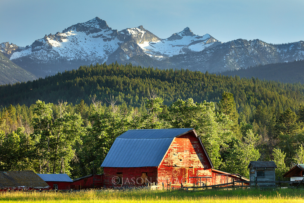 "The Como Peaks or ""Three Sisters"" provide a Montana spring backdrop to an old barn in the Bitterroot Valley."