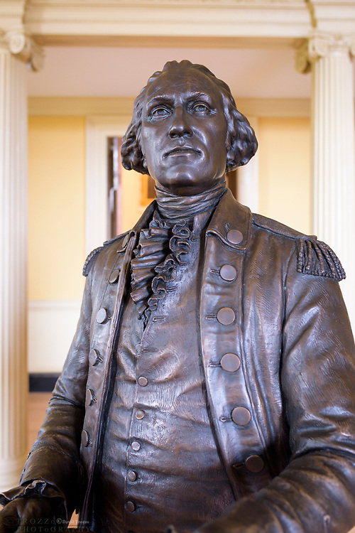 A lifesize bronze statue of General George Washington, the first president of the United States of America stands in the Maryland State House, Annapolis, Maryland.