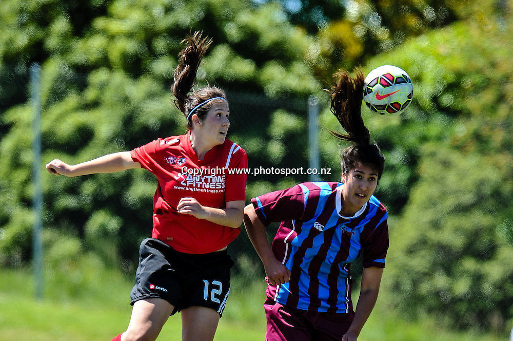 Jessie Clark-Grant of the Football South and Lauren Dabner of the Mainland Pride fight for a header in the ASB Womens League match, Mainland Pride v Football South, 23 November 2014. Photo:John Davidson/www.photosport.co.nz