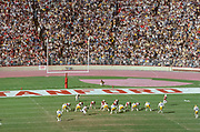 PALO ALTO, CA - NOVEMBER 17:  The Stanford team enters the field before the the 82nd Big Game between Cal and Stanford played on November 17, 1979 at Stanford Stadium in Palo Alto, California.  Visible players include Turk Schonert #14 at quarterback.   Photograph by David Madison | www.davidmadison.com.