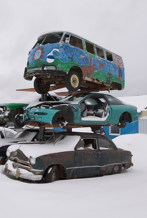 A Volkswagen bus tops a stack of cars at a junkyard near Marquette, Michigan.