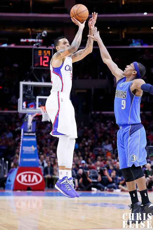 10 January 2014: Los Angeles Clippers forward Matt Barnes (22) takes a jump shot over Dallas Mavericks guard Rajon Rondo (9) during the Los Angeles Clippers 120-100 victory over the Dallas Mavericks, at the Staples Center, Los Angeles, California, USA.