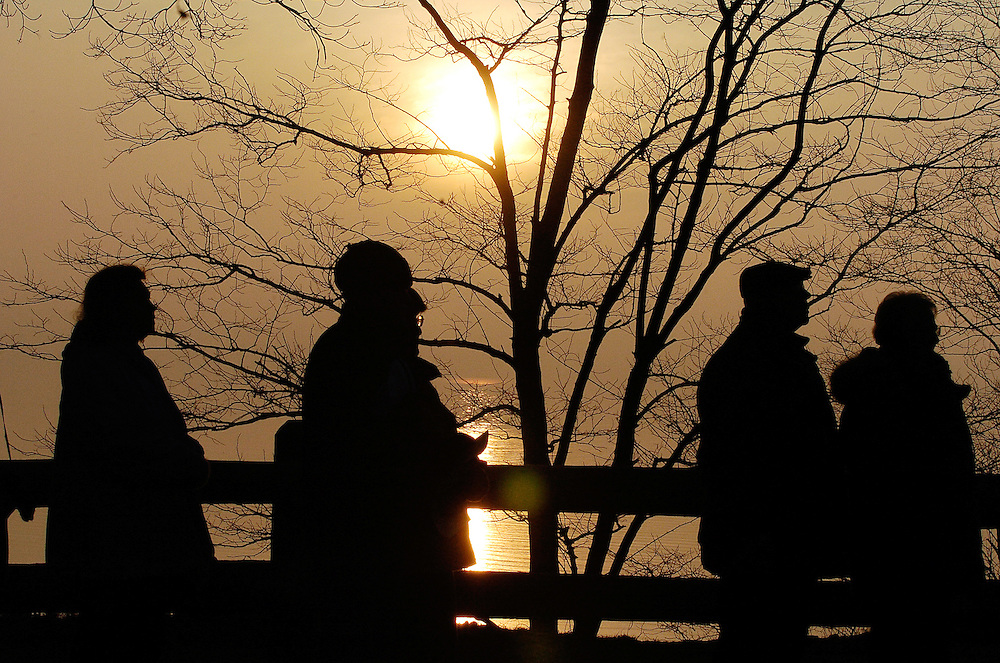 EASTER SUNRISE -- The sun rises over Lake Michigan as members of Divine Mercy Parish in South Milwaukee participate in a sunrise Easter Mass. Over 400 people turned out for the outdoor liturgy at Grant Park, located in South Milwaukee on a bluff overlooking Lake Michigan. (Catholic Herald photo by Sam Lucero)