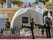 Cuba's revolutionary guard goose step in front of the tomb after the internment of Cuban leader Fidel Castro at the Santa Ifigenia cemetery in Santiago de Cuba on Sunday, December 4, 2016.