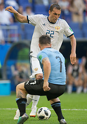 June 25, 2018 - Samara, Russia - Artem Dzyuba of Russia vies Cristian Rodriguez of Uruguay during the 2018 FIFA World Cup Russia group A match between Uruguay and Russia at Samara Arena on June 25, 2018 in Samara, Russia. (Credit Image: © Foto Olimpik/NurPhoto via ZUMA Press)