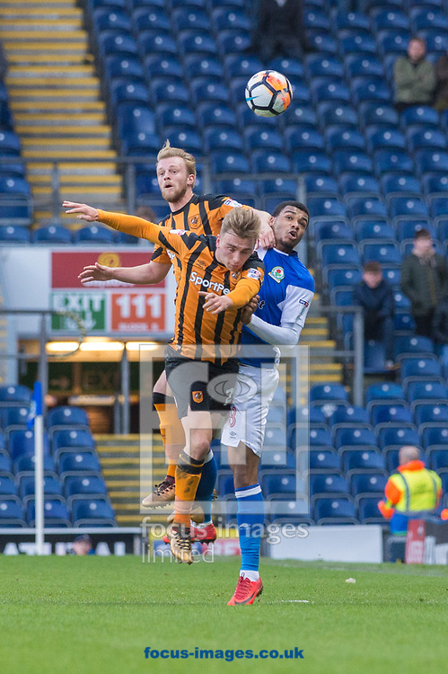 Jarrod Bowen (centre) and Max Clark of Hull City combine to win a challenge with Joe Nuttall of Blackburn Rovers during the FA Cup match at Ewood Park, Blackburn<br /> Picture by Matt Wilkinson/Focus Images Ltd 07814 960751<br /> 06/01/2018