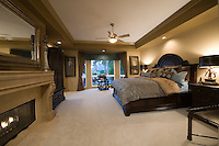 Palm Springs bedroom with dark wood furniture