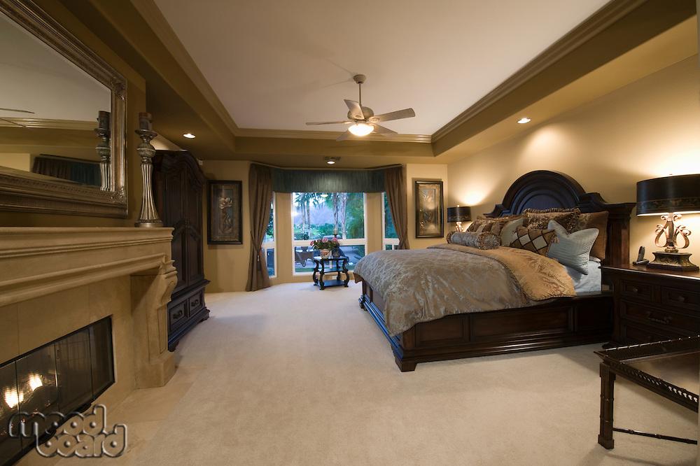 Palm Springs bedroom with dark wood furniture