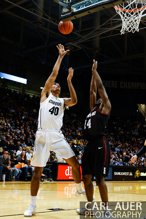 November 24th, 2013:  Colorado Buffaloes sophomore forward Josh Scott (40) attempts a shot over Harvard Crimson junior forward Steve Moundou-Missi (14) in the first half of action in the NCAA Basketball game between the Harvard Crimson and the University of Colorado Buffaloes at the Coors Events Center in Boulder, Colorado