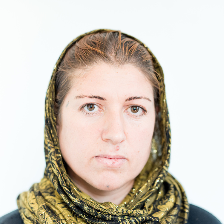 Gule Khudida Khalaf a 30 year old Yazidi from Dougre, northern Iraq. <br /> <br /> This is a series of portraits of Yazidi refugees who were stranded since April 2016 in Greece.  All of them survived the Yazidi Genocide by ISIS in August 2014 and most of them have lost family members.