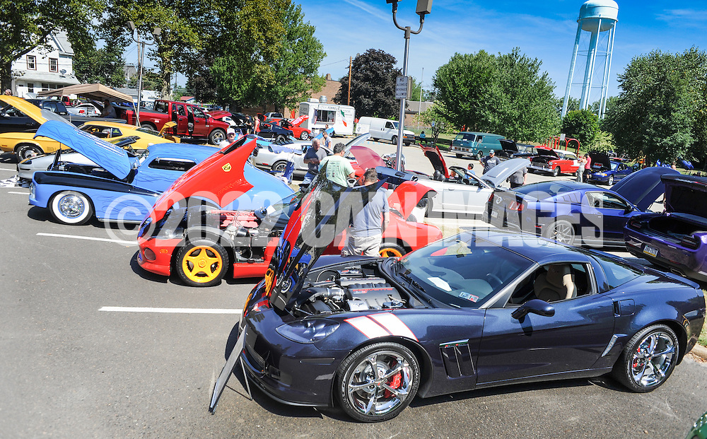 People view cars on display during a car show presented by Bucks County Stangz at the Bucks County Senior Center Saturday August 27, 2016 in Morrisville, Pennsylvania.  (Photo by William Thomas Cain)