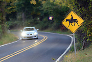 TOWNBY18P<br /> A horse crossing sign rests on the side of the road as a vehicle passes by Thursday October 8, 2015 in Wrightstown Pennsylvania. Wrightstown is a Bucks County community that is not as much of a destination as the towns around it. (William Thomas Cain/For The Inquirer)