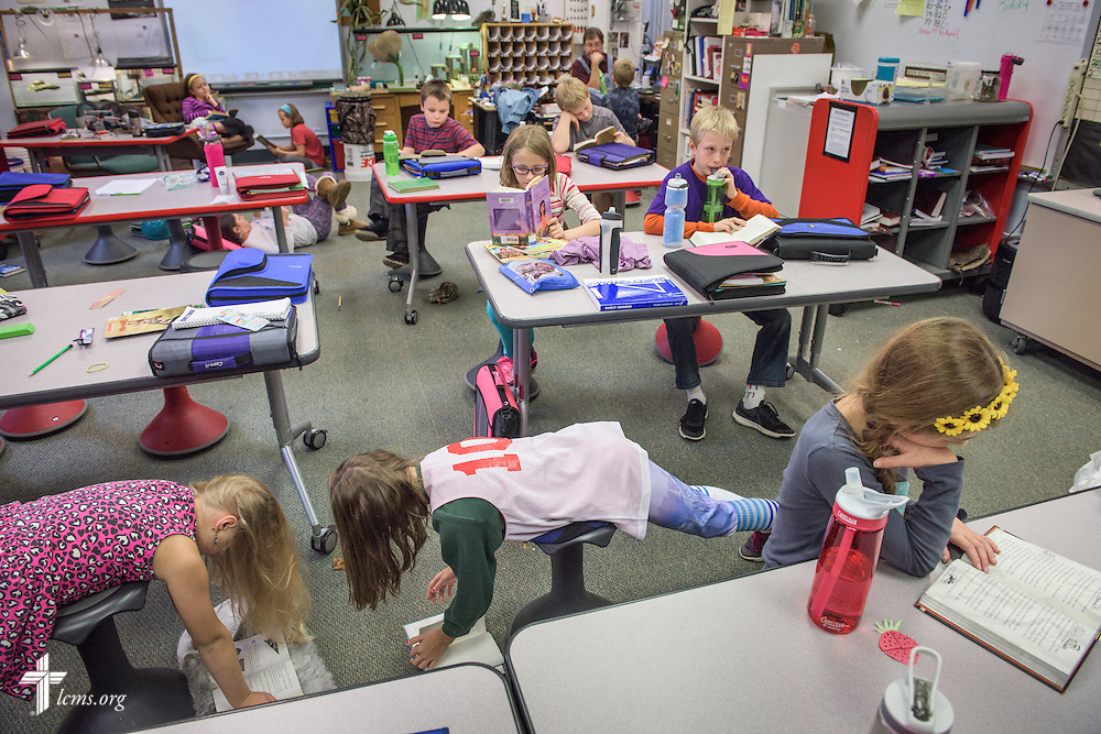 4th grade students find their own comfortable ways to read during quiet reading time on Thursday, Oct. 27, 2016, at First Immanuel Lutheran School in Cedarburg, Wis. LCMS Communications/Erik M. Lunsford