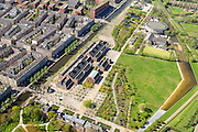 Nederland, Noord-Holland, Amsterdam, 09-04-2014;<br /> Cultuurpark Westergasfabriek en Westerpark op het voormalige  Westergasterrein, langs de Haarlemmertrekvaart en de Haarlemmerweg. Links van het kanaal woonwijk de multiculturele Staatsliedenbuurt en bij oude watertoren de nieuwbouw Waterwijk.  <br /> <br /> Culture park Westergasfabriek and the Westerpark on the former Westergasterrein (gasworks), and residential district on the other side of the channel.<br /> luchtfoto (toeslag op standard tarieven);<br /> aerial photo (additional fee required);<br /> copyright foto/photo Siebe Swart