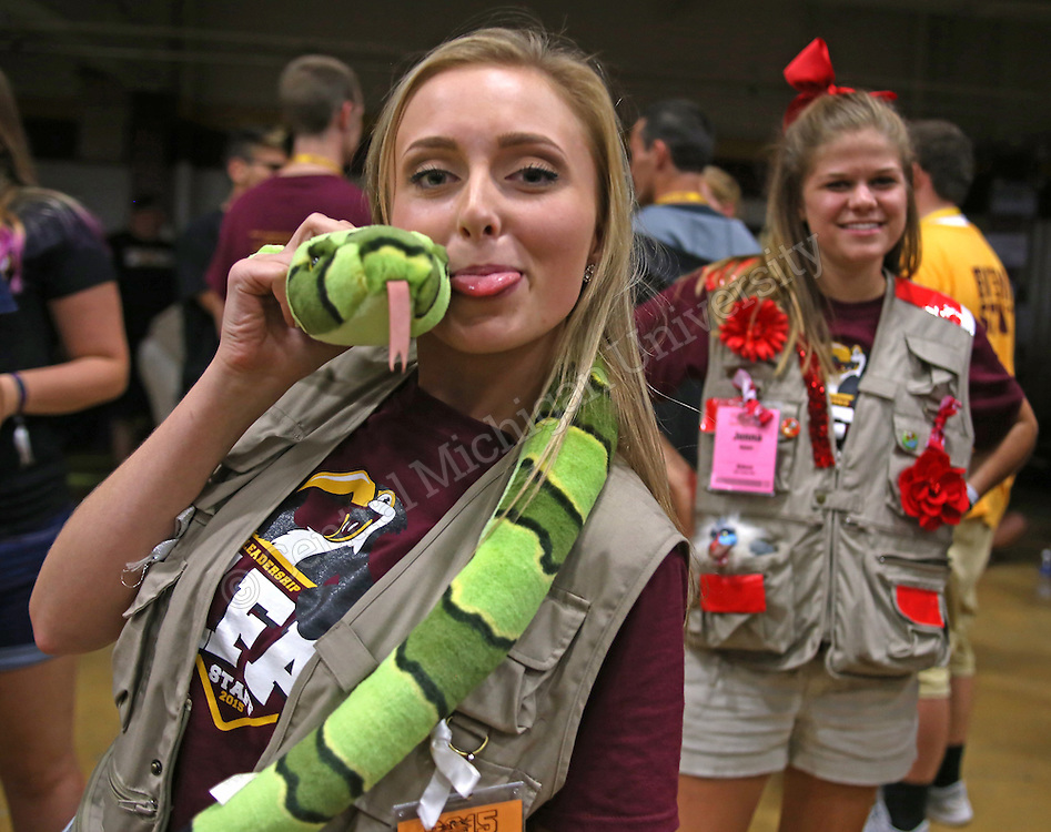 Jessica Price, safari guide for team python, poses for a photo with her stuffed python during Leadership Safari photo by Claire Abendroth