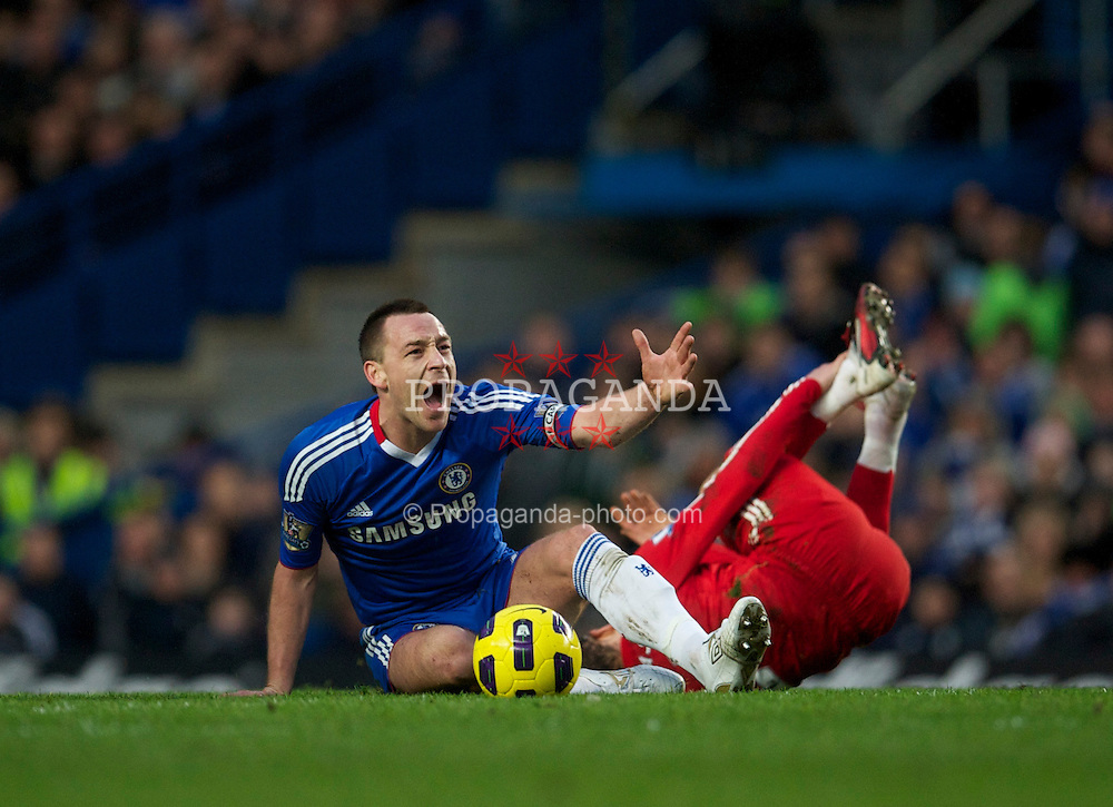 LONDON, ENGLAND - Sunday, February 6, 2011: Chelsea's captain John Terry dives in two-footed on Liverpool's Lucas Leiva during the Premiership match at Stamford Bridge. (Photo by David Rawcliffe/Propaganda)
