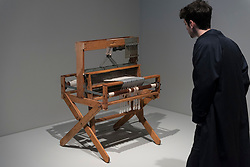 "© Licensed to London News Pictures. 09/10/2018. LONDON, UK. A visitor views Anni Albers's ""eight harness Structo-Artcraft 750 loom"".  Preview of the UK's first exhibition of works by German artist Anni Albers at Tate Modern who used the ancient art of hand-weaving to produce works of modern art.  Over 350 of her artworks from major collections from Europe and the US are on show 11 October to 27 January 2019.  Photo credit: Stephen Chung/LNP"