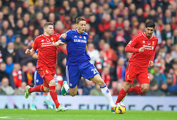 LIVERPOOL, ENGLAND - Saturday, November 8, 2014: Liverpool's Alberto Moreno in action against Chelsea's Nemanja Matic during the Premier League match at Anfield. (Pic by David Rawcliffe/Propaganda)