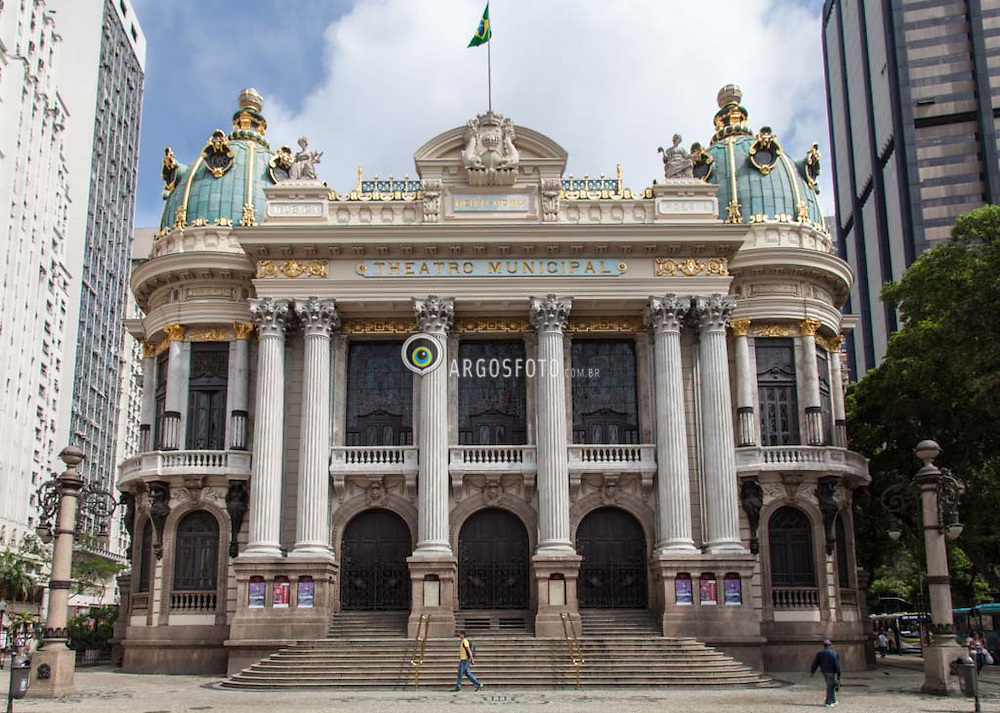 O Teatro Municipal do Rio de Janeiro localiza-se na Cinelandia (Praca Marechal Floriano), no centro da cidade do Rio de Janeiro (RJ), no Brasil. Inaugurado em 1909, exerce desde sua inauguracao um importante papel para a cultura carioca e nacional /   The Theatro Municipal (Municipal Theatre) of Rio de Janeiro is located in Cinelandia (Praca Marechal Floriano) in the city center of Rio de Janeiro, Brazil. Built in the beginning of the twentieth century, it is considered to be one of the most beautiful and important theatres in the country...The building is designed in an eclectic style, inspired by the Paris Opéra of Charles Garnier. The outside walls are inscribed with the names of classic Eurocentric & Brazilian artists. It is located near the National Library and the National Fine Arts Museum, overlooking the spacious Cinelandia Square.