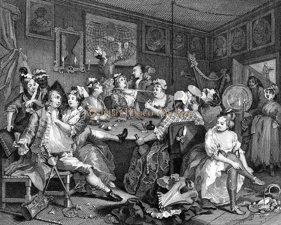 The Rake's Progress: Tavern Scene - Plate II in William Hogarth's series of eight originally published 1735. Here the Rake squanders his fortune on drink, women and gambling. Woman caressing him steals his watch and hands it to accomplice behind him. Engraving