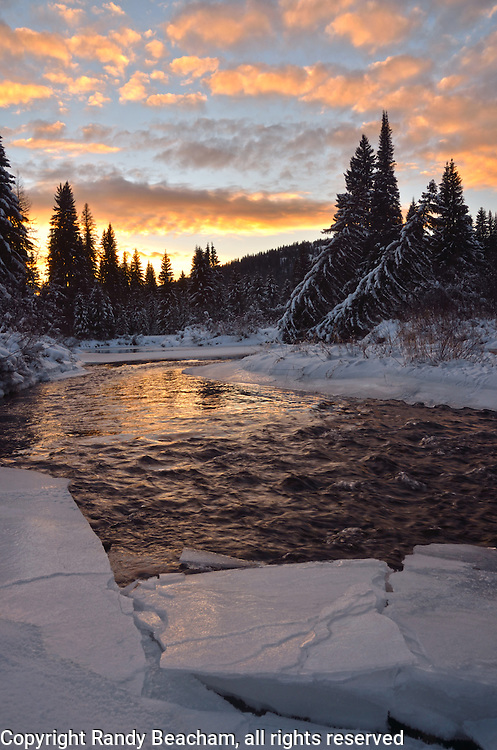 Ice along the Yaak River at sunset in winter. Yaak Valley in the Purcell Mountains, northwest Montana.
