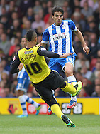 Picture by David Horn/Focus Images Ltd +44 7545 970036<br /> 28/09/2013<br /> Lewis McGugan of Watford and Jordi Gomez of Wigan Athletic during the Sky Bet Championship match at Vicarage Road, Watford.