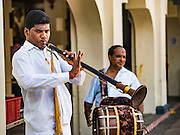 27 DECEMBER 2015 - SINGAPORE, SINGAPORE: Musicians perform during Sunday prayers at Sri Mariamman Temple in Singapore. The Sri Mariamman Temple is Singapore's oldest Hindu temple. It is an agamic temple, built in the Dravidian style. The temple is in the downtown Chinatown district, and serves Hindu Singaporeans and Tamilians. Due to its architectural and historical significance, the temple has been gazetted a National Monument and is a major tourist attraction. The Sri Mariamman Temple was founded in 1827 by Naraina Pillai, eight years after the East India Company established a trading settlement in Singapore.       PHOTO BY JACK KURTZ