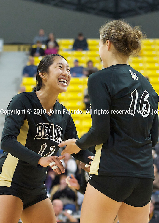 Ashley Lee(L) and Delainey Aigner-Swesey(16) celebrate the point in the Mizuno Thanksgiving Tournament match against Seattle University at the Walter Pyramid, Long Beach, Calif., Saturday, Nov. 27, 2010