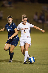 Virginia Cavaliers M Julia Falk (6) shields the ball from Liberty Flames M/F Amy Oberlin (17) ..The #4 ranked Virginia Cavaliers defeated the Liberty Flames 5-0 at Klockner Stadium in Charlottesville, VA on September 21, 2007