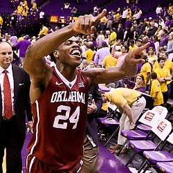 Jan 30, 2016; Baton Rouge, LA, USA; Oklahoma Sooners guard Buddy Hield (24) celebrates as a leaves the court following a win against the LSU Tigers in a game at the Pete Maravich Assembly Center. Oklahoma defeated LSU 77-75. Mandatory Credit: Derick E. Hingle-USA TODAY Sports