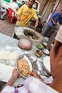 Bread made on a street in Paharganj, Delhi. <br /> Vegetarian Street Food in India.