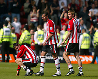 Photo. Chris Ratcliffe, Digitalsport<br /> Southampton v Manchester United. Barclays Premiership. 15/05/2005<br /> Southampton players Calum Davenport, Claus Lundekvam and Rory Delap are gutted