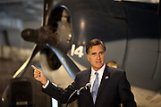 Republican presidential candidate Mitt Romney addresses a group of veterans during a visit to the aircraft carrier USS Yorktown museum on October 6, 2011 in Charleston, South Carolina.