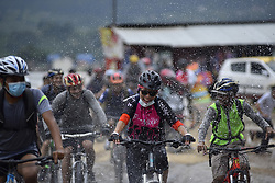 July 21, 2018 - Kathmandu, Nepal - Cyclists enjoys as water drops splash by the people during Kathmandu Kora Cycling 2018 RIDE for a CAUSE at Chobhar, Kathmandu, Nepal on Saturday, July 21, 2018. Riders from Nepal as well as from different countries participated to ride a challenge of 50 km, 75 km and 100 km around Kathmandu Valley on its eighth edition of KATHMANDU KORA. (Credit Image: © Narayan Maharjan/NurPhoto via ZUMA Press)