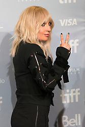 """Lady Gaga gestures as she leaves a photo call before appearing at the press conference for """"Gaga: Five Foot Two"""" at the Toronto International Film Festival, in Toronto on Friday, September 8, 2017. THE CANADIAN PRESS/Chris Young"""
