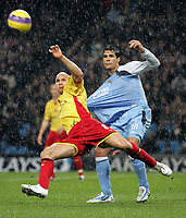 Photo: Paul Thomas.<br /> Manchester City v Watford. The Barclays Premiership. 04/12/2006.<br /> <br /> Bernardo Corradi (R) of Man City has the ball cleared it front of him by Gavin Mahon of Watford.