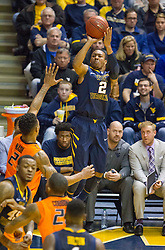 West Virginia Mountaineers guard Jevon Carter (2) shoots a three pointer against the Oklahoma State Cowboys during the second half at the WVU Coliseum.