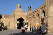 General view of traders in the arcades, Tok-i-Sarrafon or Moneychangers' Bazaar, Bukhara, Uzbekistan, pictured on July 8, 2010 in the afternoon. The Tok-i-Sarrafon Bazaar, or Moneychangers' Bazaar, is one of the remaining domed Bazaars originating in the 16th-17th century trading boom along the Silk Road. Here Punjabi moneychangers would exchange Russian, Persian and Afghan currency into local coinage. Bukhara, a city on the Silk Route is about 2500 years old. Its long history is displayed both through the impressive monuments and the overall town planning and architecture. Picture by Manuel Cohen.