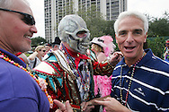 "Florida Governor Charlie Crist reacts with humor to meeting ""a Mummer"" before the start of the 2007 Gasparilla parade in Tampa, Florida."
