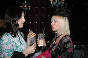 Susie Cave and Virginia Bates. party given by Daphne Guinness for Christian Louboutin  after the opening of his new shopt.  Baglione Hotel. 16 March 2004.  ONE TIME USE ONLY - DO NOT ARCHIVE  © Copyright Photograph by Dafydd Jones 66 Stockwell Park Rd. London SW9 0DA Tel 020 7733 0108 www.dafjones.com